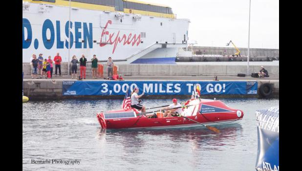 Luverne High School graduate Caitlin Miller (sitting on boat) waves to the crowd Dec. 20, 2015, as she and her rowing partner, George Pagano, set out from the Island of LaGomera on a 3,000-mile trip across the Atlantic Ocean.