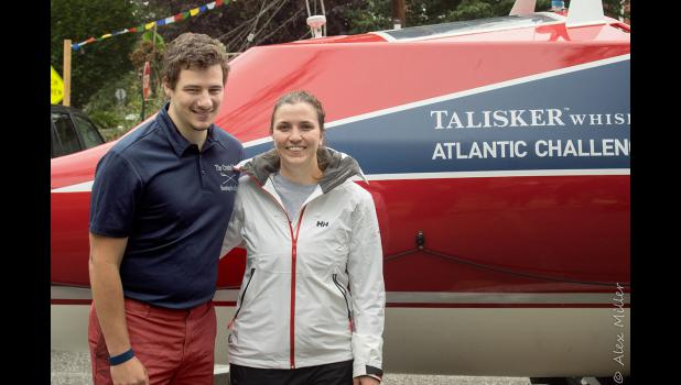 "George Pagano and Caitlin Miller pose in front of their rowboat, ""Washington's Crossing,"" the first U.S.-made boat to compete in the ""Talisker Whiskey Atlantic Challenge."""