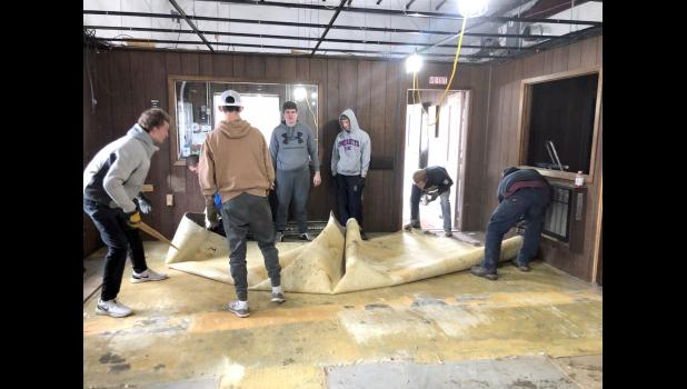 """Members of the Hills-Beaver Creek High School football team donated some of their time by demolishing walls in the former New Vision Co-op in Hills. The building will become an office and structure for Game Plan 4 Hope and will be named """"Team-E Fieldhouse of Hope."""""""