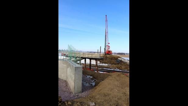 Workers with Prahm Construction of Slayton pound a bridge piling on the north side of the Burlington Northern Santa Fe Railroad Jan. 9 on County Road 52 southwest of Beaver Creek. The bridge was destroyed by fire in July 2017, and after delays in funding, contractors and railway supervision, work is back on track for an expected March completion, weather permitting.
