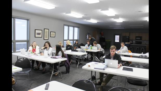 Students in the 2019-20 Creating Entrepreneurial Opportunities class work Tuesday morning in the Edgerton Emergency Management Services building on specific tasks for Sunday's CEO Subzero Extravaganza in Luverne. From left are Rylee Gee, Bryn Mongeau, Lindsey Truijilo, Brenna Henning, Regan Feit, Isabel Smeins, Cade Wenninger, Colby Crabtree, Nathan Nekali, Austin Taylor and Jonathan Eisma.