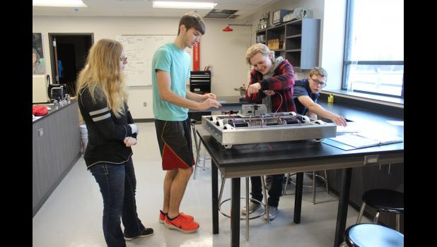 A week after receiving the kit, Melanie Rittenhouse (left), Jonah Friedrichsen, Martin Anderson and Marshal Oakes have the base assembled for Luverne High School's first industrial-sized robot.