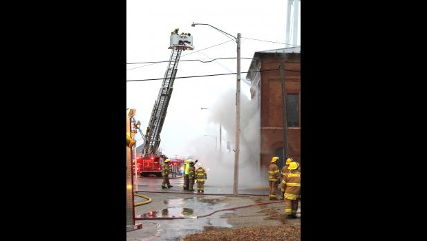 Luverne Fire Department used its ladder truck to direct water into the second story of the Ellsworth City Hall.