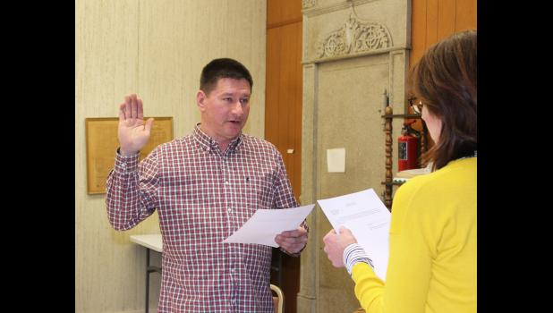 Willie Baker (left) takes the oath of office Wednesday night, Jan. 9, with Hardwick City Clerk Tammy Johnson. Baker was elected to a two-year term as mayor.