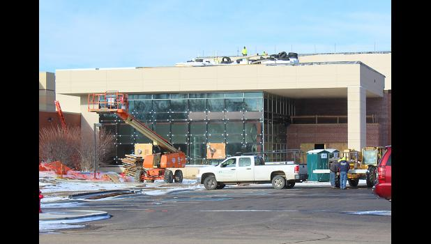 Contractors removed the plastic covering from the front of the new commons and entry at Luverne Middle School-High School this week. As a state project, the $30 million renovation and remodel does not factor in Luverne's building permits, nor does it contribute to Luverne tax base.