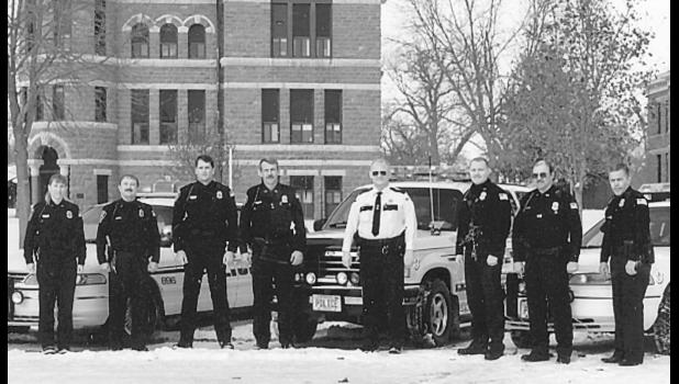 Members of the Luverne Police Department in 1997 included Holly Emslander, Gerry Vorderbruggen, Brad  Berning, Mike Winkels, Police Chief Keith Aanenson, Jason Aanenson, Jim Sandstede and Lon Remme. This Star Herald photograph was taken in December 1997 just before the Police Department and Rock County Sheriff's Office joined under the Sheriff's Office.