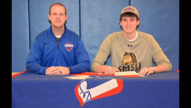 Marshall-bound Hills-Beaver Creek High School senior Zach Scholten (right), pictured with H-BC head football coach Rex Metzger, signed a Letter of Intent to play football at Southwest Minnesota State University in Marshall Wednesday (Feb. 1). Scholten lettered for four seasons at H-BC and is a three-time all-conference selection. The son of Kraig and Kristi Scholten passed for 60 touchdowns and 4,400 yards during his football career at H-BC