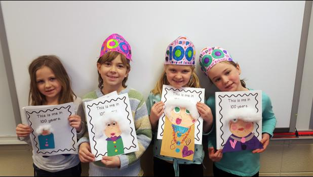 First-graders in Sue Hup's class recognize the 100th day of school through a project on what they would look like when they are 100 years old. Students crumpled paper to depict their wrinkled faces. Pictured with their projects from left are Nevaeh Groen, Reagan Gangestad, Tenley Behr and Isabella Steensma.