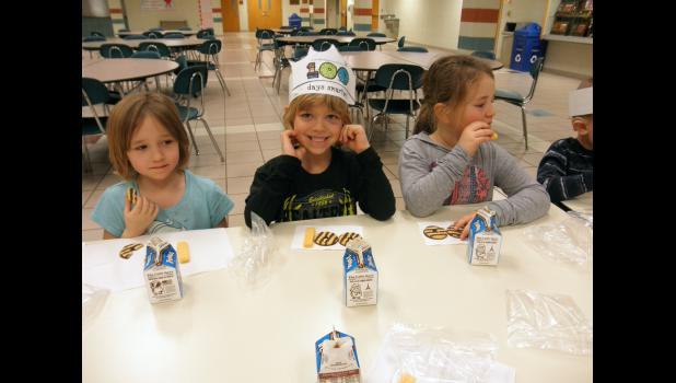 "Enjoying a ""100"" snack are Dakotah Sina, Saul Hoven and Ellie VanBatavia."