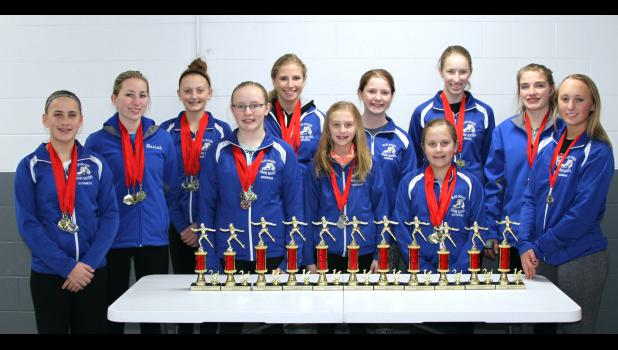 Twelve members of the Blue Mound Figure Skaters captured the first-place team trophy at the Yankton Winter Miracle Feb. 20-21 in Yankton, South Dakota. Pictured (from left) are Elisabeth Kelm, Moriah Flanagan, Maranda Thier, Breanna Richters, Brooke Top, Marisa Thier, Hannah Henning, Katharine Kelm, Anisa Vanden Bosch, Ashley Hohn and Hannah Hofer. Not pictured: Mara Thier.
