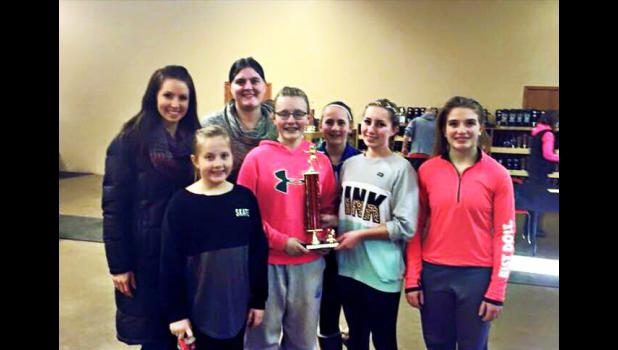Accepting the first-place team trophy for the Blue Mound Figure Skaters are (from left) Courtney DeBoer, Katharine Kelm, Sarah Nuffer, Elisabeth Kelm, Breanna Richters, Moriah Flanagan, and Ashley Hohn.