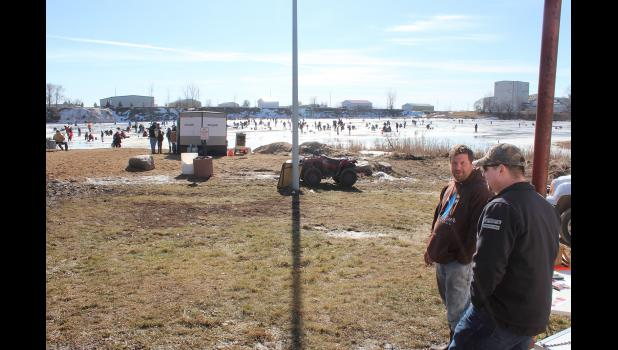 Mike Davis (left) and Andrew Blank visit near the weigh station on the beach.