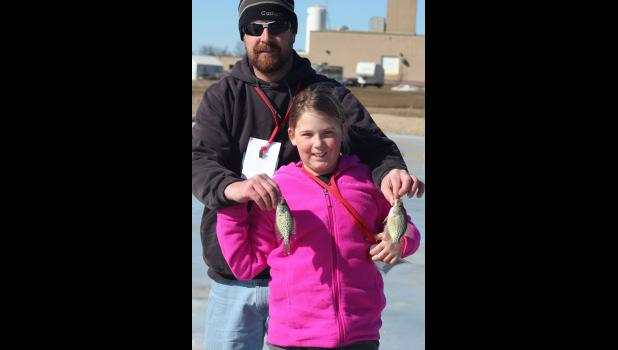 Gracie Nath, 10, lets her dad, Chris Nath, hold her crappies for the photo.