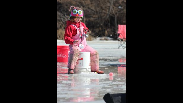 Emersyn Remme, 5, gets comfortable on her bucket.