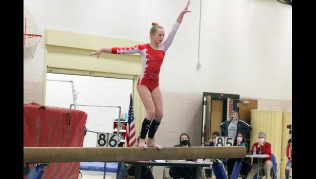 Ella Reisdorfer performs on the beam during Luverne's home meet against Marshall on Thursday, Feb. 25. Reisdorfer set the program record in the event with a score of 9.35.