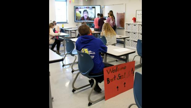 """A """"Welcome Brent Sass!"""" poster leans against a desk Monday afternoon as sixth-graders at Luverne Middle School conduct a Zoom interview with the Alaskan musher."""