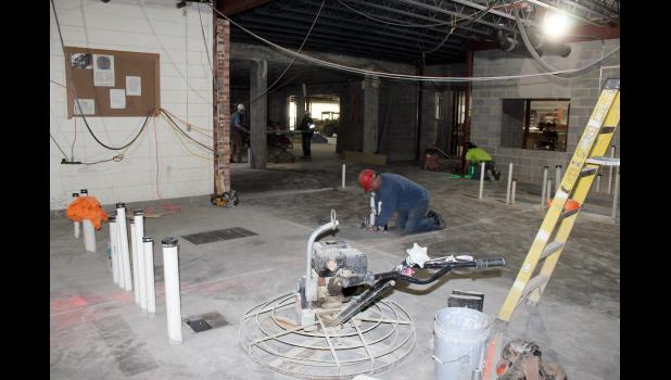The new Luverne Middle-High School kitchen will replace the current basement cafeteria. Workers check the plumbing for the various work stations on Feb. 24.