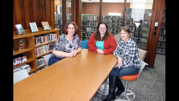 Librarians (from left) Bronwyn Wenzel, Serena Gutnik and Barb Verhey sit in the new teen room at the Rock County Community Library. After two months of construction, the library will reopen to patrons Monday.