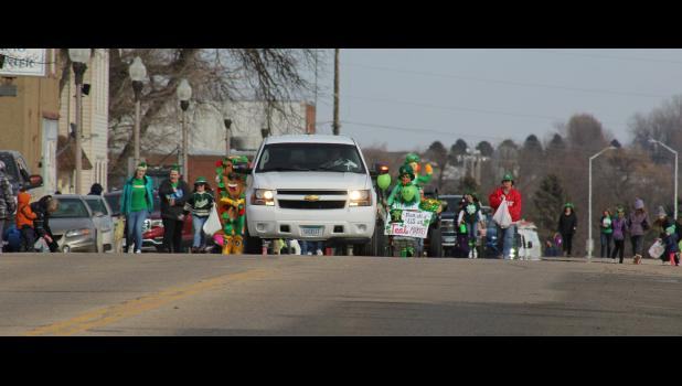 Sheriff Evan Verbrugge leads the annual St. Patrick's Day parade Monday afternoon down Main Street Luverne.