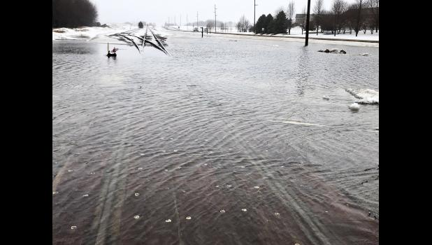 Water covers the railroad tracks at the intersection of Gabrielson Drive in Luverne.