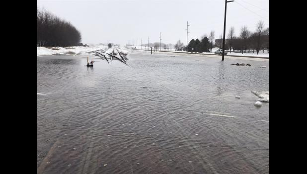 Water creeps over the railroad tracks at the Gabrielson Drive intersection near Gevo and County Road 4 in Luverne.