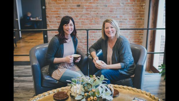 Business partners and friends Manda Steensma (left) and Vicki Altena are seeking a new owner for their WildFlowers Coffee Boutique but will keep the business open and operating as usual until the right buyer can be found.