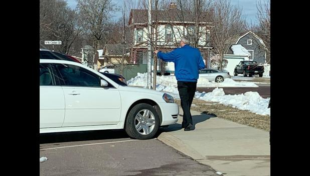 After the 9 a.m. Mass, Monsignor Gerald Kosse blessed about 10 vehicles and their occupants in the church parking lot, who watched the live Mass Sunday from their cars.