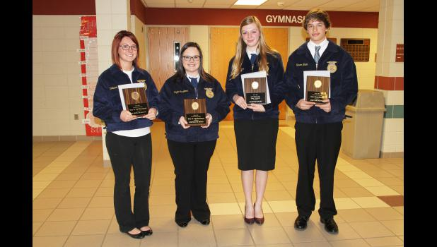 Earning the local chapter's top awards are (from left) Karissa Hamann, ag placement; Stephanie Riggs, agribusiness; Ryleigh Beers, star farmer and DeKalb award; and Trevor Mente, greenhand.