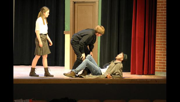 Abner Johnson (center, played by Michael Kinsinger) confronts Drexton (Paul Witte III) about why Drexton is asking questions about Johnson's expulsion from school. Betty Ann (Hannah Hoogland) looks on as her secret love Drexton tries to explain why.