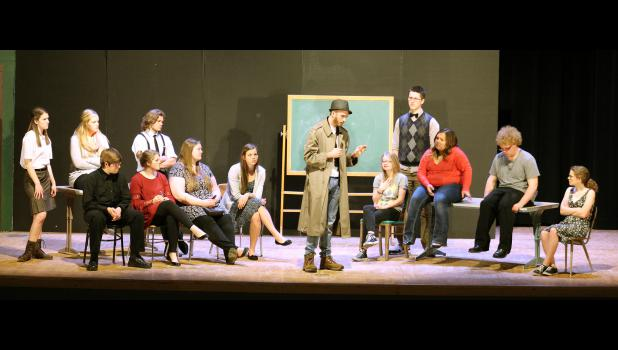 The final chapter brings both decathlon teams together as Drexton Cage (center, played by Paul Witte III) talks through who would have stolen answers for the upcoming meet. Pictured from left are Betty Ann (Hannah Hoogland), Patience (Emma Verbrugge), Abner (Michael Kinsinger), Sylvia (Freddi Stroeh), Reginald (Brandon Claussen), Electra (Katerina Siebert), Cloris (Carly Serie), Cage, Giggles (Ashlee Boltjes), Sincere (Aiden Bartels), Parker (Emily Wendland), Smilin' Bob (Josh Schoneman) and Pensicola (Mega