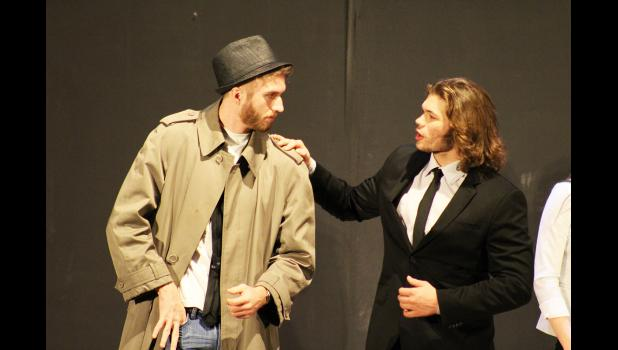 High school detective Drexton Cage (left, played by Paul Witte III) talks with his friend Reginald Wellington III (Brandon Claussen) about the members of the Chandler High School IQ-decathlon team and the legacy agreement Wellington's family has for his automatic acceptance to Harvard University.