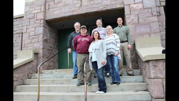 Seven members comprise Reclaim Community, a not-for-profit group organized to purchase and restore the former Jasper High School for community use. Pictured from left are (front) Elicia Kortus, (second row) Terry Skyberg, Kristie Weinkauf, (back) Randy Larson, Jason Madtson and Ryan Reker. Missing is Jon Hoyme.