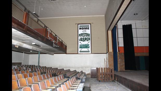 A sign still hangs in the former Jasper High School.