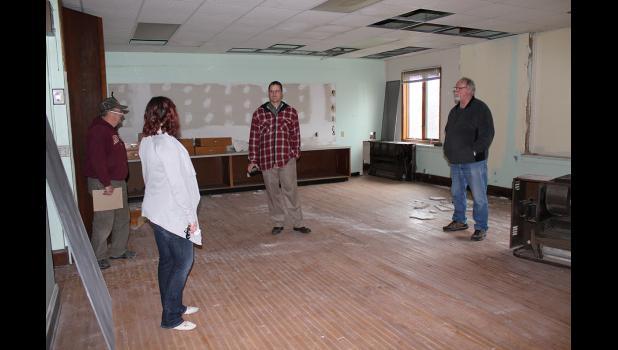 Reclaim Community members talk in a former fourth-grade classroom.