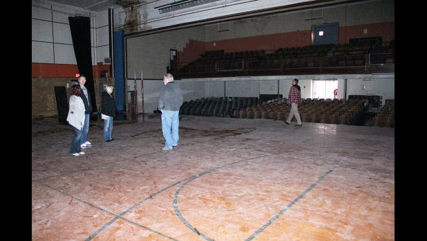 For many Reclaim Community members, a tour last week provided the glimpse inside the building for the first time. In the gymnasium a roof leak is contained to the northwest corner.