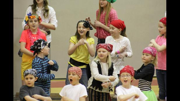 "Fourth-grader Gracie Walker (center) sings ""We've Got Friends"" with classmates Ariel Kruse (left) and Morgan Hadler (right). Pictured in the first row from left are first-graders Isaiah Walker, Andrew Deutsch, Anna Reisdorfer, (second row) Braydan Overgaard, Sylvia Eisma and Hannah Cowell."