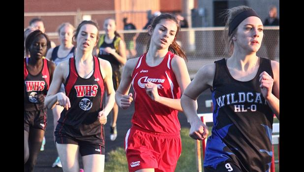Luverne's Gabrielle Ferrell keeps pace with Heron Lake-Okabena's Cheyenne Schaffer during the opening lap of the 800-meter run at the Cardinal Relays in Luverne April 12. Ferrell won the event with a time of 2:35.63.