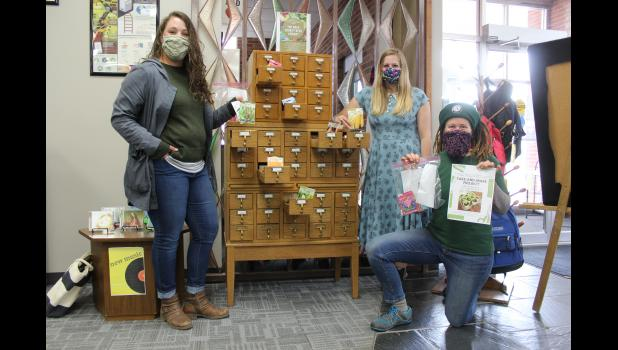 A seed library opened today at the Rock County Library in Luverne and was organized (from left) by Erin Hamann, library director Calla Jarvie and Berty Stearns. The seed library is free, encouraging patrons to take and plant the flower and vegetable seeds.