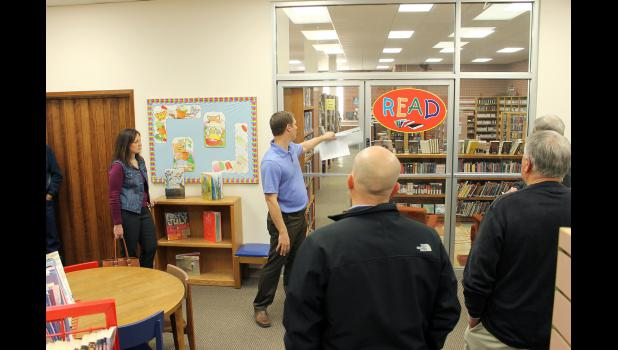 Rock County Community Library Director Clint Wolthuizen explains the glass doors separating the children's room from the rest of the library will be removed in a proposed $175,000 renovation project. Rock County Commissioners toured the facility before adding the project to their Capital Improvement Plan for 2015. Pictured from left are Ron Boyenga, Sherri Thompson, Wolthuizen, Jody Reisch, Ken Hoime and Stan Williamson.