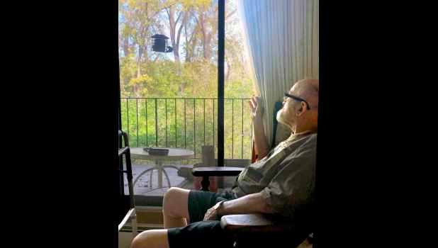 John Feight's favorite pastime was bird-watching from his favorite chair near the large picture window of his apartment.