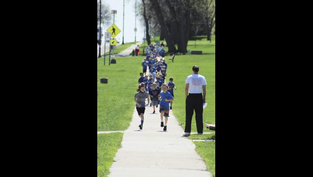 Sage Viessman (left) and Blaik Bork lead the Second Annual Cardinal Dash Friday afternoon around the Luverne School Campus. Fifth-grade teacher Gordie Hansen (far right) monitors the more-than-one-mile course.