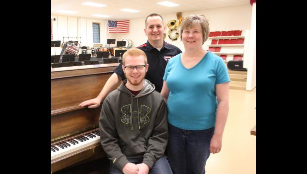 Mitchell Graber (front) composed a song for Friday's band concert. He's pictured with his choral director Seana Graber and band director Richard Owen.
