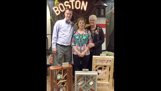 Award recipients at Saturday night's Hospice Charity Dinner and Auction include (from left) Nate Golla, 2016 Friend of Hospice; Brigitte Wieneke, 2016 Hospice Team Member; and Glenda Schomacker, 2016 Hospice Volunteer. They were presented with unique art pieces designed by Luverne artist Cody Henrichs.