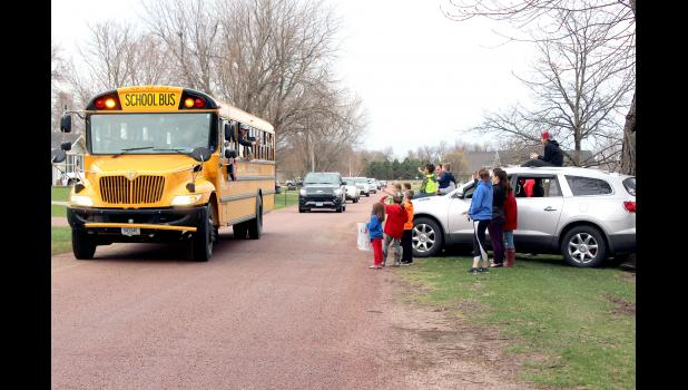 Four school buses and 30 personal vehicles made up Friday's Hills-Beaver Creek School District's teacher parade that drove through the district communities of Steen and Beaver Creek and ended in Hills (pictured above). Residents lined porches, parks and boulevards to wave and hold up signs in greeting to teachers.