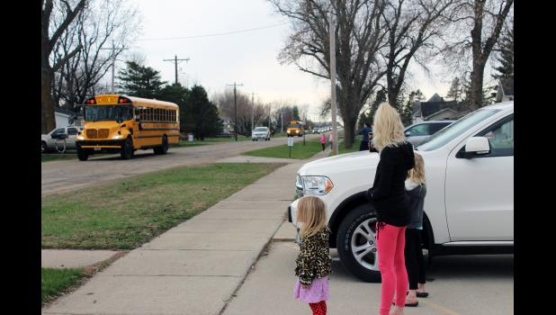 Brandi Balster drove daughters Amara (left) and Tenley into Steen Friday to view the Hills-Beaver Creek School District teachers' parade.