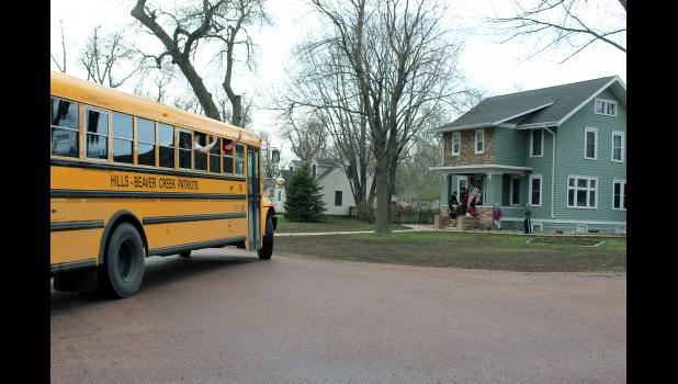 A Hills-Beaver Creek School District bus wraps up the teachers' parade Friday as the route winds its way through Hills.