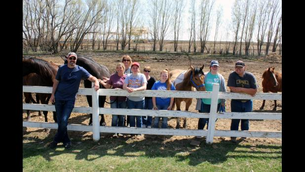 As construction continues in the background at Rock Ranch west of Hills for a new indoor arena, Dan and Marie LaRock (far left) work with volunteers Monday to prepare the ranch and its horses for the 2020 therapy sessions. From left are Dan and Marie LaRock and volunteers Lisa Dinger, Alexis Gardner-Swenson, Dolores Bundeson, Sylvia Fick, Michaela Abels and Gus Jacobson.