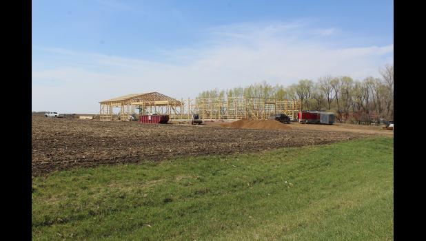 Rafters are lifted into place Monday by Balster Construction workers at the new indoor arena currently under construction at the Rock Ranch west of Hills. The facility, which offers three unique equine therapy programs to individuals, is expected to be in operation by June.