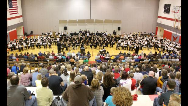 "Students in grades 5-12, under the direction of Richard Owen and Angie Swenson, perform in a combined band the final number of Friday night's concert, ""Shorewood Overture,"" by Michael Story."