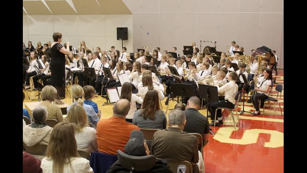 """Angie Swenson directs fifth-grade band members in their performance of """"Camptown Races."""""""